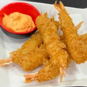 langostinos rebozados hechos en tempura de panko y acompañado de salsa de curry